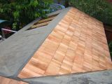 Felt and shingles extended to existing summer house roof